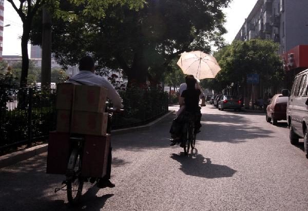 Bicycling with Umbrella in Beijing