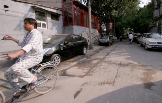 Cycling through Beijing in a Pyjama