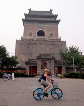 Bicycling on a Rented Bike in front of Drum Tower