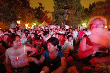 Beijing Residents watching the Beijing Olympics Opening Ceremony