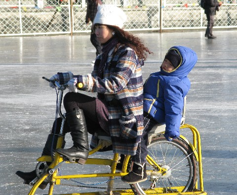 Lady with Child Ice Biking