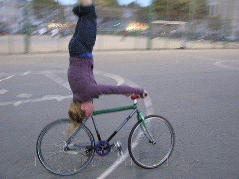 Ines Shoulderstand on Track Bikes