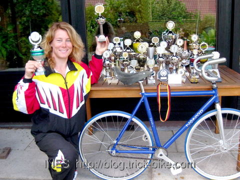 Ines and her Bike with their Trophies