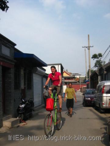 Lulu Riding the Tall-Bike