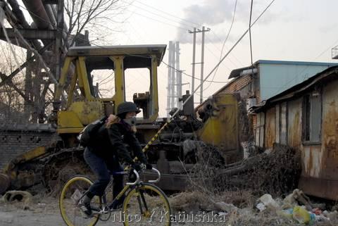 Cycling outside of Beijing Steel Factory