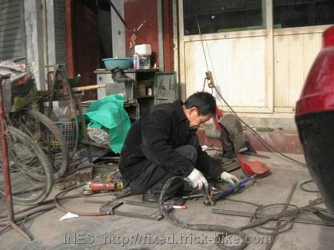 Chinese welder working on my trick bike fork