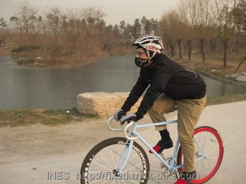 Shannon fixed gear cycling in park