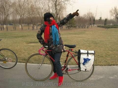 Katiushka and her bike in park
