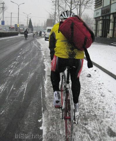 Cycling in Snowy Beijing without Fenders