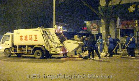 Garbage Trucks Collecting the Snow Piled up Along the Streets of Beijing