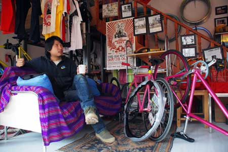 Liu in Ines Brunn's Bicycle Shop Natooke