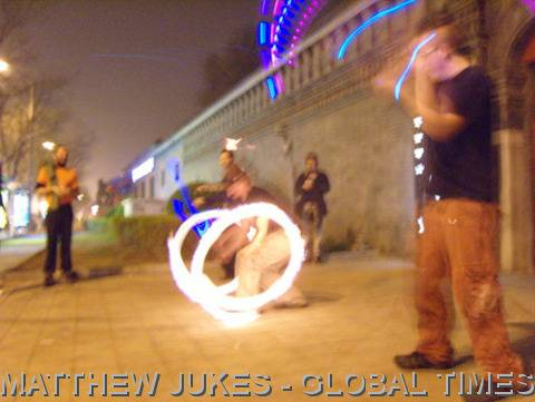 fire poi on the street in Beijing