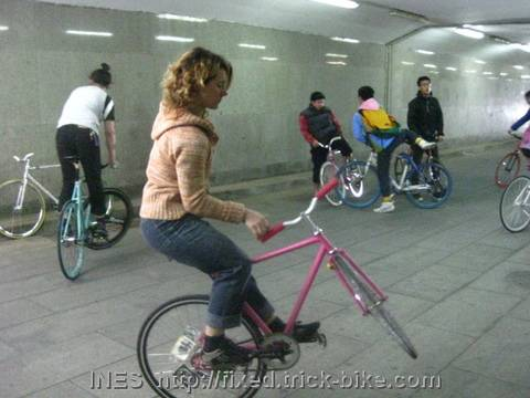 Ines doing bike tricks