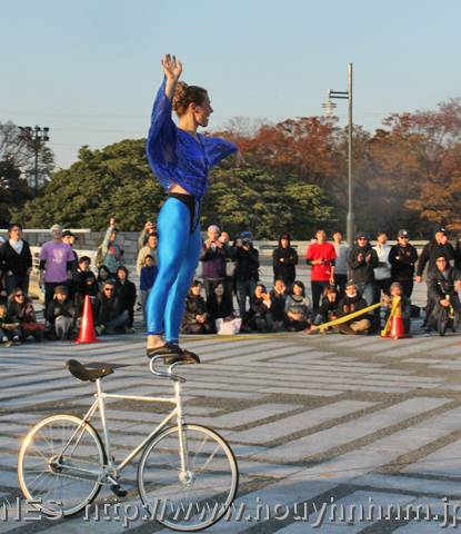Ines Brunn doing bike tricks in Japan
