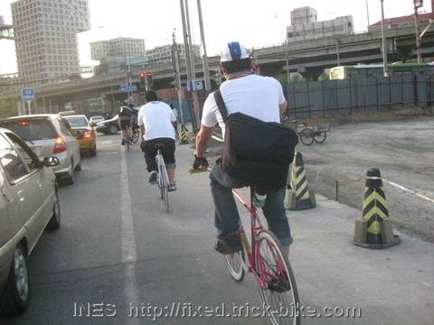 Riding past construction sites in Beijing