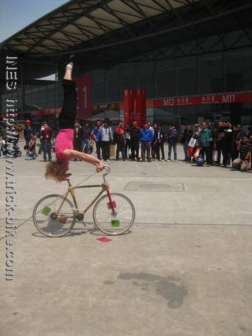 Ines Brunn doing a Headstand on Bamboo Bike