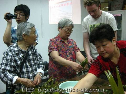 Community Ladies teaching how to make Zongzi