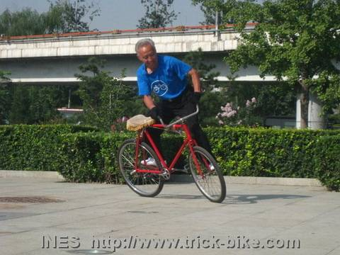 Yu Changqing Doing Bike Tricks