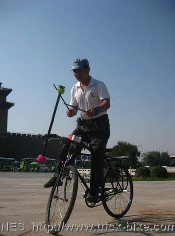 Playing Flower Stick on Bicycle