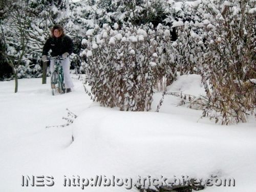 Ines bike riding in snow