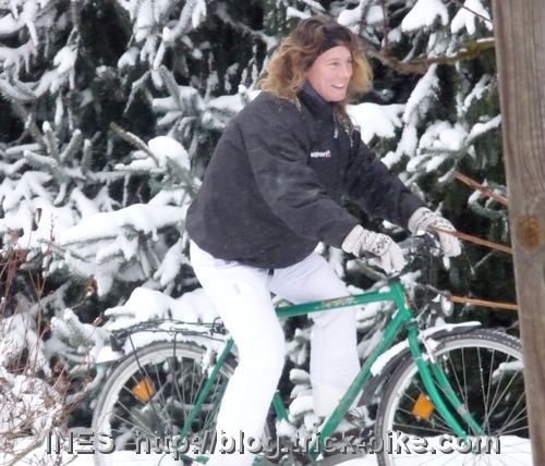 Ines having fun on a bike in the deep snow