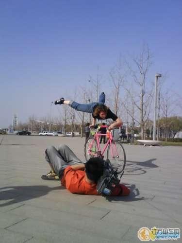 Ines doing bike tricks for TV