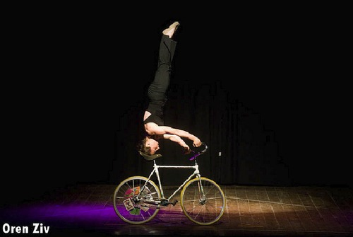 Ines Brunn doing a Headstand on the Bicycle