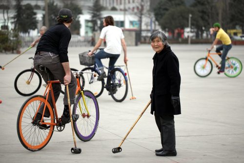 Elderly Woman Excited about Bike Polo